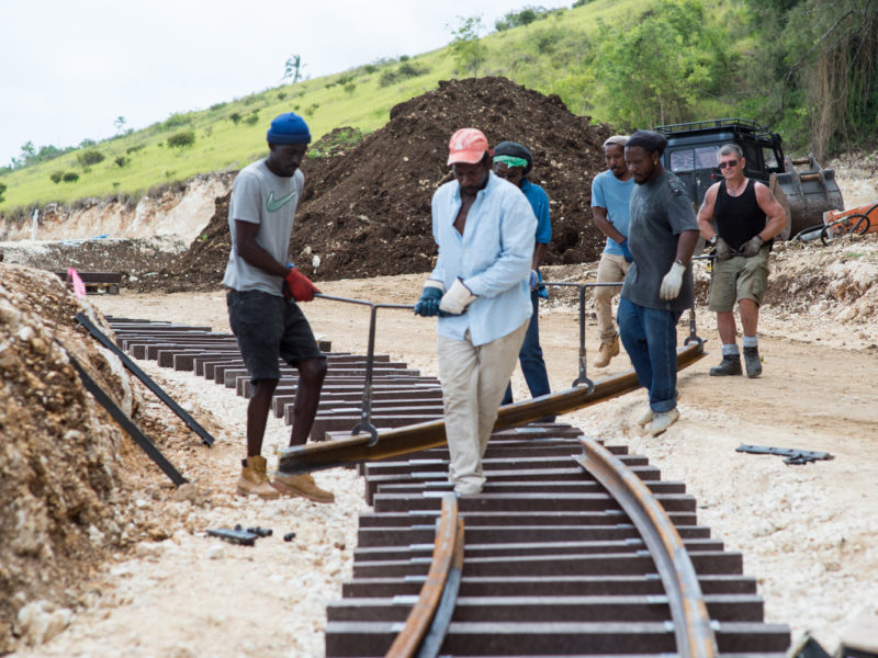 Track workers installing a length of rail. Photo by Sofie Warren.